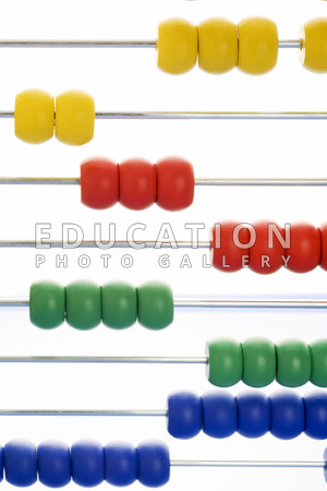 Abacus. Close-up of coloured beads on an abacus. The abacus is an early form of arithmetic calculator.