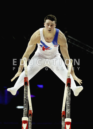 Kristian Thomas of Great Britain on the Parallel Bars during day one of the Men's Gymnastics Olympic Qualification round at North Greenwich Arena on January 10, 2012 in London, England.  (Photo by Ian Walton/Getty Images)