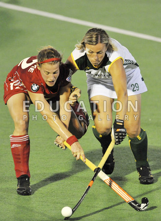 Gaelle Valcke of Belgium and Tarryn Bright of South Africa in action competing for the ball in the Investec Series Womens International Hockey game between South Africa and Belgium which is being played Randburg Hockey Stadium and was being held on February 01, 2012 in Randburg, South Africa.  (Photo by Duif du Toit/Gallo Images/Getty Images)