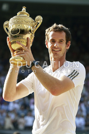 Andy Murray of Great Britain holds the Men's Singles Trophy following his victory in his Final against Novak Djokovic of Serbia at the Wimbledon Lawn Tennis Championships at the All England Lawn Tennis and Croquet Club on July 7, 2013 in London, England.  (Photo by Clive Brunskill/Getty Images)